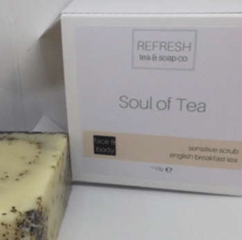 "Photo of a bar of tea soap and its box which has the fragrance name ""Soul of Tea."""