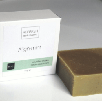 "Photo of a bar of tea soap and its box which has the fragrance name ""Align-Mint."""