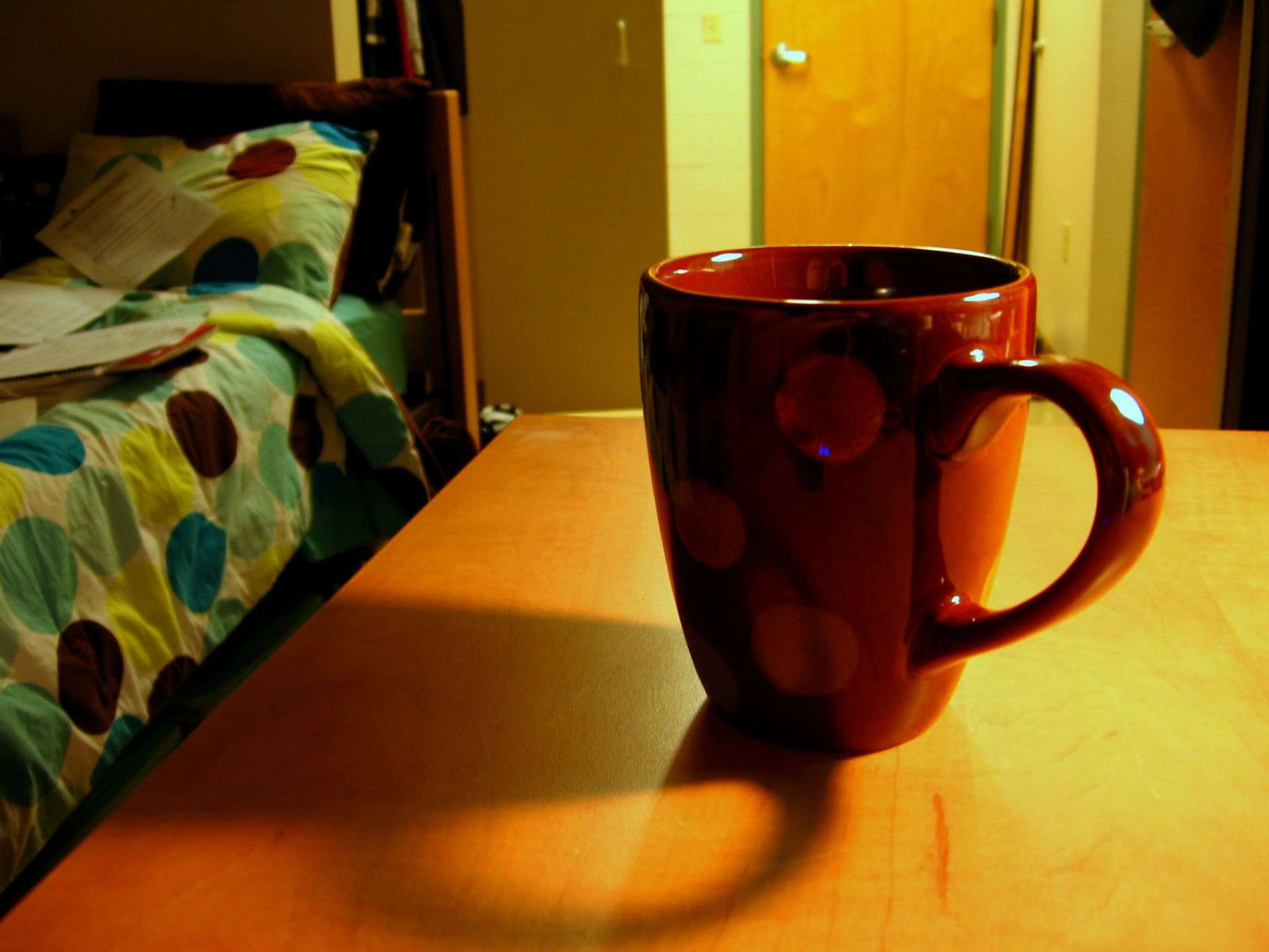 T Ching Classics: Tea and Sleep - Photo of a mug on a nightstand next to a bed