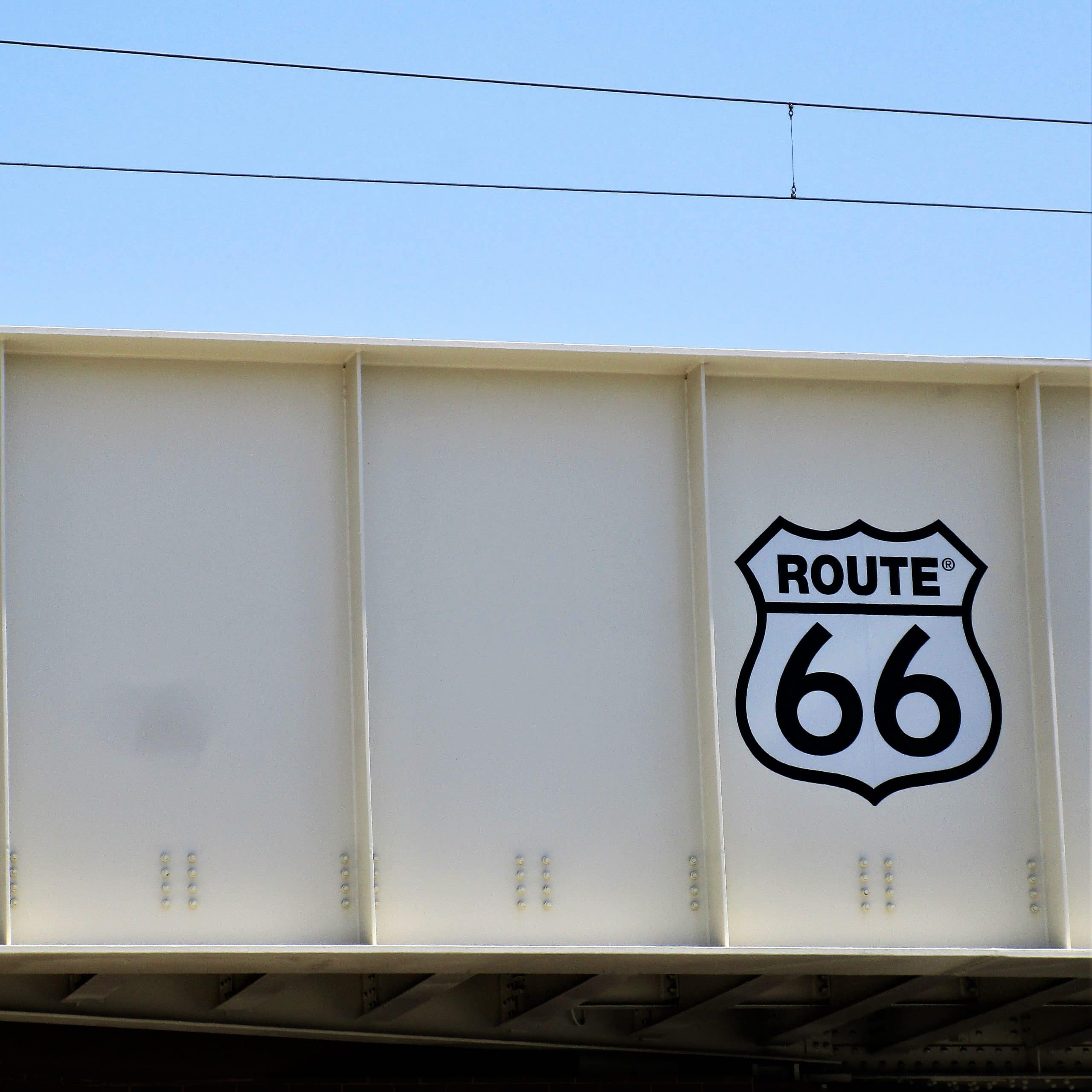 """Tea Along U.S. Route 66 - Photo of """"Route 66"""" sign on an overpass."""
