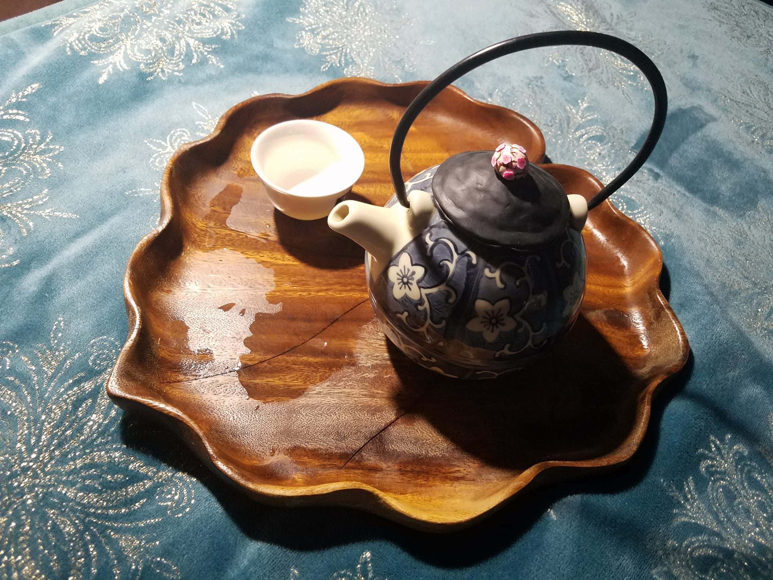 Updating an Old Teapot and Telephone Tea Date - A photo of a teapot and teacup on a wooden tray