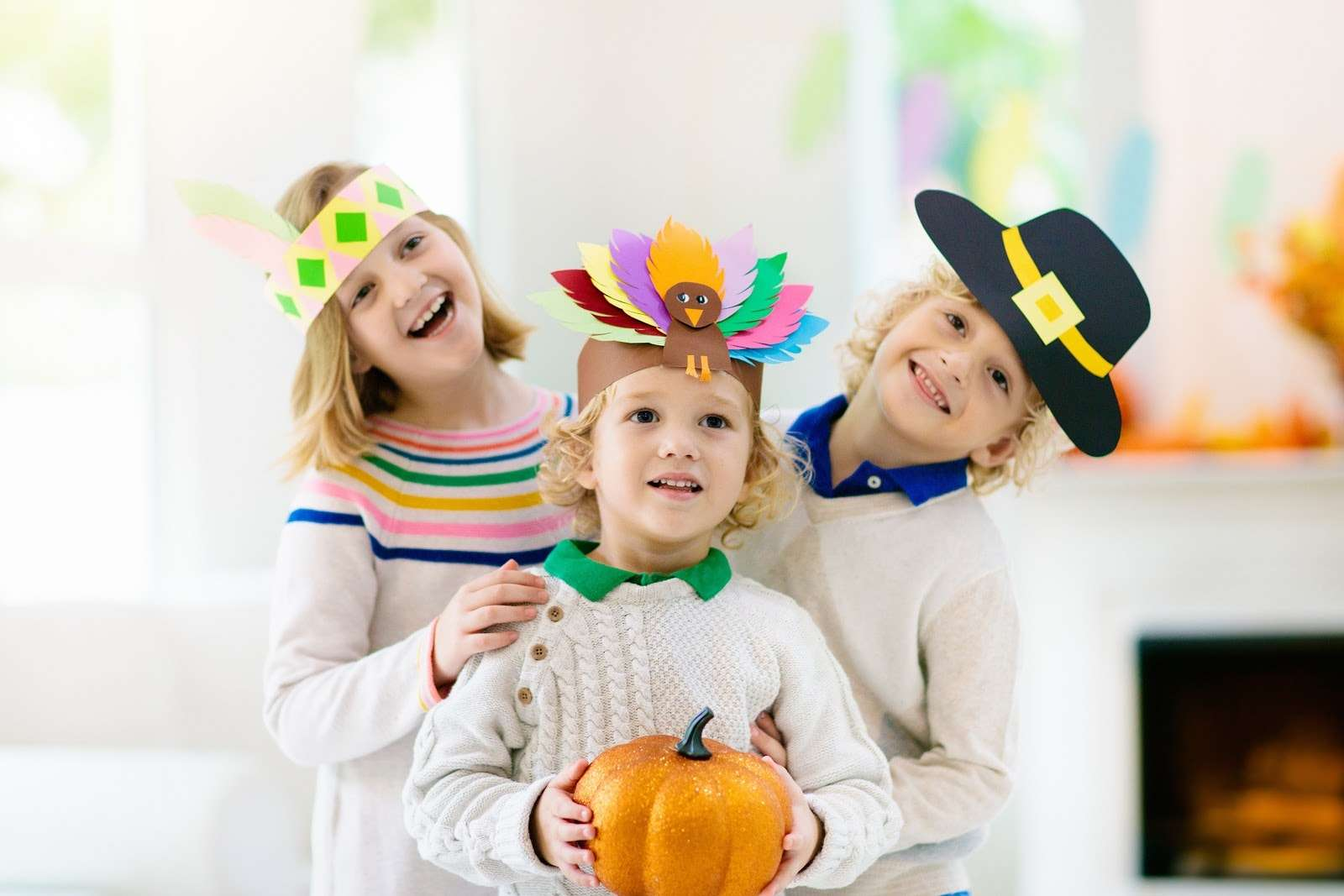 The Courage to be Grateful - Photo of three children in construction paper hats