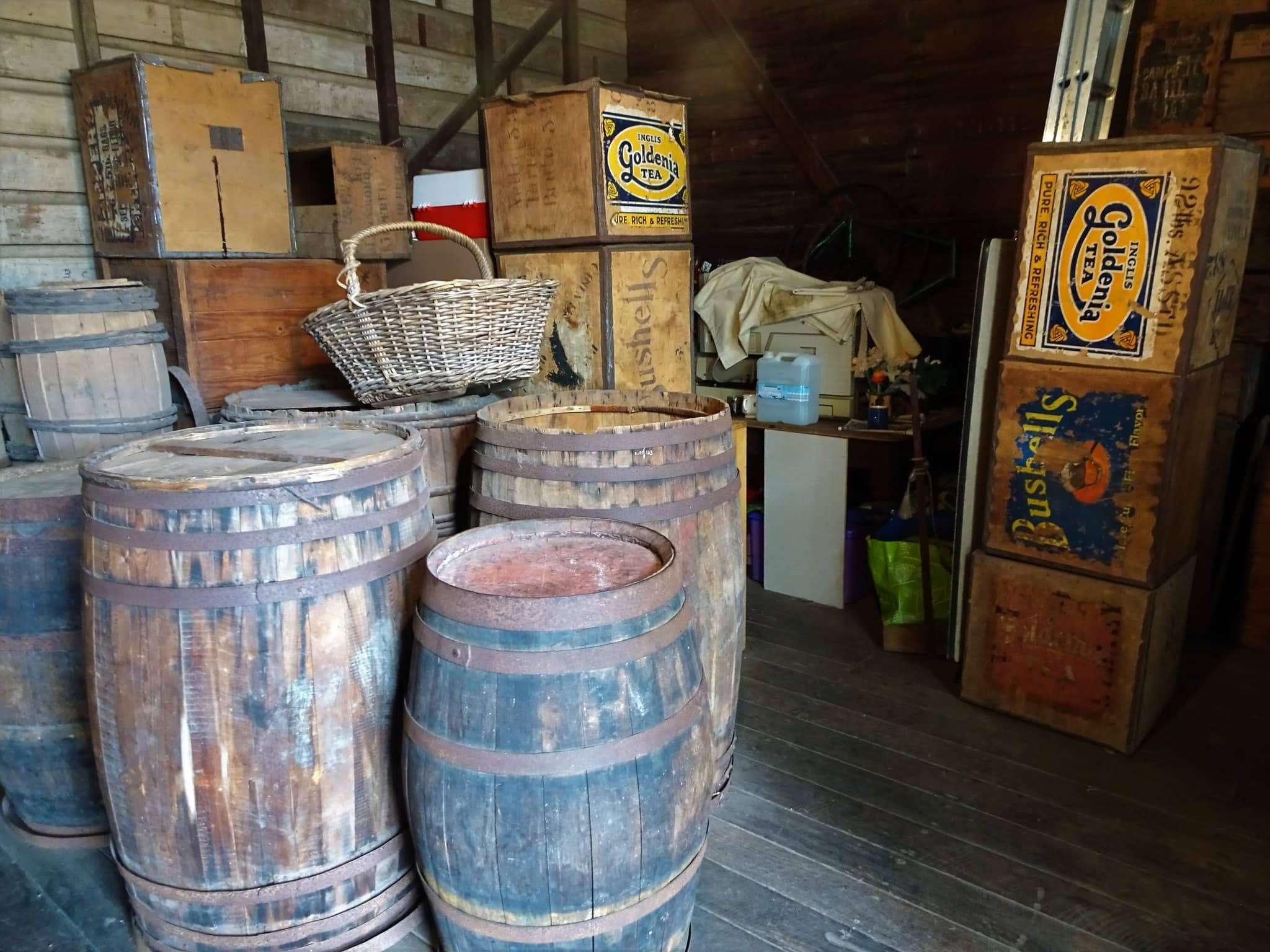 T Ching Classics: Tea Storage - Photo of barrels and crates of tea.